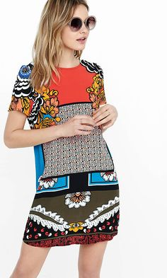 Between its easy fit, the airy feel of its light rayon crepe and its amazingly vivid mix of colors and floral prints, this shift dress is like a wearable tropical getaway. Style it simply with sandals or wear it as a tunic top over jeans or leggings.