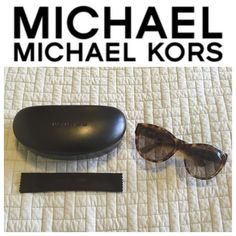 """NWOT Michael Kors Sunglasses Brand new, never worn, without tags! Brown tortoise Michael Kors Sunglasses! STUNNING and a great compliment to any outfit! Circular """"MK"""" logo on both sides of the arms. Thick, sturdy plastic with brown lenses. Comes with original, brand new brown leather case and cleaning cloth! 100% AUTHENTIC Michael Kors Accessories Sunglasses"""
