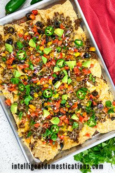 Easy recipe for Loaded Sheet Pan Beef Nachos using fresh ingredients. Includes how to make your own seasoning and sauce for this versatile dish. Serve Sheet Pan Loaded Nachos for a snack, game day food, Taco Tuesday dish or a weeknight meal. #easyrecipe #dinneridea Yummy Appetizers, Appetizer Recipes, Snack Recipes, Dinner Recipes, Delicious Recipes, Easy Recipes, Weeknight Meals, Easy Meals, Beef Nachos