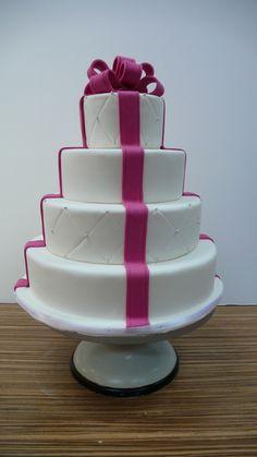 Classic wedding cake with fuchsia ribbon., via Flickr.