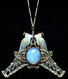 Art Nouveau artists - Lalique Jewelry. Pendants. I've grown fond of jewelry that has birds on it especially owls.