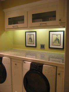 Kitchen cabinets from Ikea were used and the counter is made of granite tiles. The lower cabinets slide out for easy access. - Love the front loaders, counter over both, & pull-out cabinets... and under-cabinet lighting.