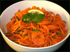 carrots   Time: 15 min  Yield: 3 cups  Nutrition:  193.1 calories  9.5 grams of fat  14.4 grams of sugar  305.3 milligrams of sodium  Ingredients:  3 Thick Carrots  2 Tablespoons Chopped Cilantro  1 Tablespoon Chopped Green Onion (green part only)  3 Tablespoons Orange Juice  2 Teaspoons Lemon Juice  2 Teaspoons Extra Virgin Olive Oil  1/4 Teaspoon Ground Cumin  1/8 Teaspoon Sea Salt  Dash Cinnamon  Dash Cayenne Pepper  Dash Freshly Ground Black Pepper  Instructions:  Spiralize the carrot