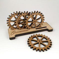 - Description - Contents - Dimensions - Material - This original handcrafted Bamboo Gear Coaster Set comes with a personalized wooden base display holder. We engrave any name on the holder surface, ma 3d Laser, Laser Cut Wood, Laser Cutting, Laser Cutter Ideas, Laser Cutter Projects, Router Projects, Wood Projects, Coaster Design, Coaster Set