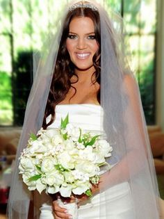 Khloe Kardashian Odom looked stunning with long loose curls on her wedding day