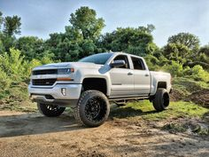 2016 Silverado with 7.5 Roughcountry lift and RBP Glock 22x14 wheels