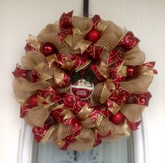 "22"" Burlap Deco Mesh Christmas Wreath with Cranberry and Gold Ribbons and Accents with Snowman Bell Ornament"