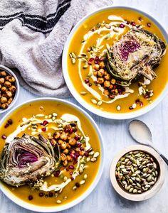 Creamy pumpkin soup garnished with crispy chickpeas pomegranate seeds toasted pumpkin seeds pumpkin cashew cream! Vegan Pumpkin Soup, Creamy Pumpkin Soup, Pomegranate Recipes, Pomegranate Seeds, Vegan Thanksgiving Dinner, Thanksgiving Recipes, Healthy Soup Recipes, Vegetarian Recipes, Vegan Soups
