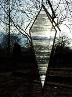 Mirrored stainless #steel. stained #glass #sculpture by #sculptor Jane Bohane titled: 'Avarice (Minimalist Kite Shaped Glass Garden statue)'. #JaneBohane