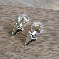 Black and gold jacket earring Front of earring has standard post back. Ear jacket attaches to the back and features small black rhinestones. Jewelry Earrings