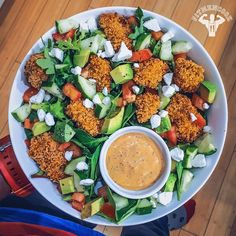 Enjoying a popcorn chicken salad that would put KFC to shame! 😂🙌 I'm taking a quick break from watching House of Cards 3 to make myself a quick salad. One of the benefits of experimenting in the kitchen on weekends is having a bunch of leftovers! (Which is only good when the recipe comes out right and today it did). Salad: spicy popcorn chicken + mixed greens + avocado + cucumbers + tomatoes + goat cheese + red pepper Greek yogurt dressing. I'll share the popcorn chicken recipe on Monday…