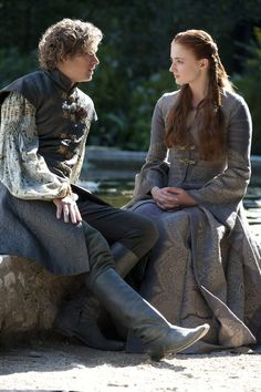 Finn Jones as Ser Loras Tyrell and Sophie Turner as Sansa Stark in 'Game of Thrones,' Season 3, Episode 306, 'The Climb'