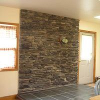 Wood stoves can be a cost effective source of household heat in the winter. A stone veneer back wall can offer all of the lasting beauty and elegance of a fireplace, as well as hide an all important safety feature. A 1-inch air ventilation space is necessary to avoid a buildup of dangerous levels of heat that can cause a devastating fire. A small...