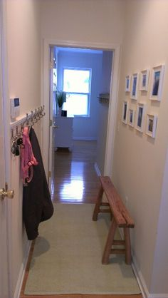 Small entryway hall-like skinny bench but under coat hooks and picture gallery above coat hooks