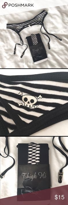 NWOT Garter Belt and Thigh High Fishnet Set NWOT * NEVER WORN black and white stripe skull garter belt with black fishnet thigh high stockings in brand new condition. Please see 3rd photo for the pattern in the stockings (partial fishnet) Hot Topic Intimates & Sleepwear