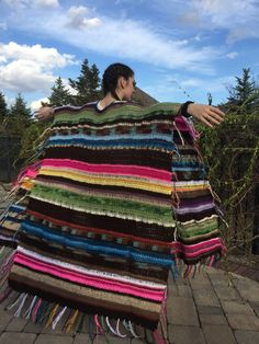 Super colorful womens festival wrap. This poncho is perfect for a walk on the beach, your favorite concert or just relaxing. Each poncho is totally unique. Custom colors can be requested as well. This shawl comes in hip length, thigh length and ankle length with costs for each.