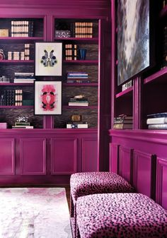 purple-hued built-ins, settees and rug