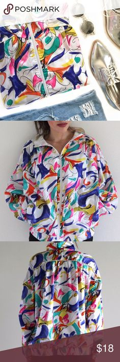 """Vintage Bocoo Retro Lightweight Zip Up Jacket The power of colours. This retro lightweight jacket features two side pockets, multicolored designs in white background, zips up the front and an elastic waistband and cuffs. Fully lined. Best fits a M or L. Shell 100% Polyester, Block 100% Nylon, Lining 65% Polyester & 35% Cotton. Jacket has two small holes on the right and left shoulder (as seen in 4th pic) which are not noticeable & easy fix.    Length: 24"""" Bust: 54"""" Waist: 48"""" Hip: 38""""…"""
