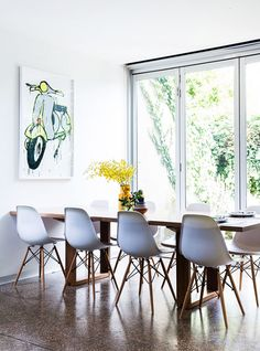 Original Jasper Knight Vespa painting, reclaimed timber table by Blueprint, bowl from South Africa, flowers from nearby Prahran Market. Photo - Sean Fennessy, production – Lucy Feagins / The Design Files. Eames Chairs, Room Chairs, Table And Chairs, Dining Chairs, Dining Table, Dining Furniture, Yellow Dining Room, Timber Table, Melbourne House