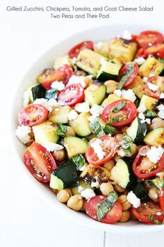 Grilled Zucchini, Chickpea, Tomato, and Goat Cheese Salad Recipe on http://twopeasandtheirpod.com. Love this simple summer salad!