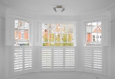 Bay window with bi-folding Tier on Tier shutters which can be opened or shut providing flexibility and confidentiality