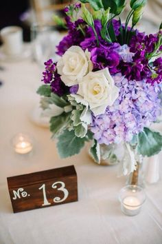 #centerpiece of #purple #hydrangea #ivory #roses #dustymiller