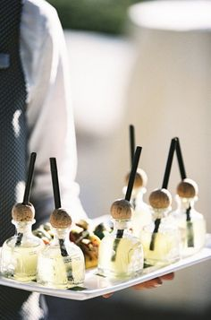 Margaritas in mini patron bottles.