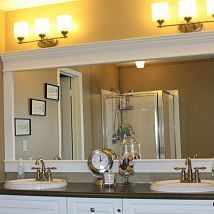 How to Upgrade your Builder Grade Mirror - Frame it! Cost us around $30