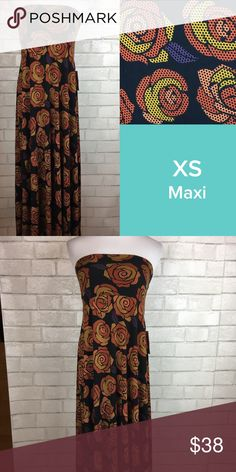 LuLaRoe XS Maxi Skirt Roses Print New! New with tags!  Gorgeous super soft LuLaRoe Size XS Maxi Skirt ( fits size 0-2) featuring full length flowing skirt with thick yoga style waistband.  Print features gorgeous digital print roses with black background background, considered a rare or unicorn item.  Slinky material.  Very versatile, can also be worn as a dress! LuLaRoe Skirts Maxi