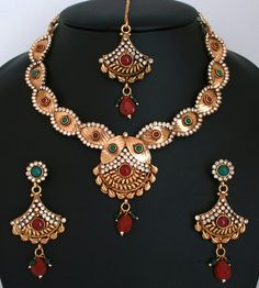 Designer fashion Indian Costume Ruby Red,White and Emerald stone polki jewelry Necklace set-011PLKJ52  http://www.craftandjewel.com/servlet/the-1716/unique-indian-costume-jewellery/Detail