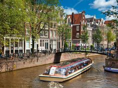 When in Amsterdam, grab some fried herring, a can of Heineken, and hop on a canal tour.