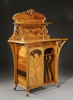Art Nouveau -  Rare mahogany music unit with a rosewood veneer top and exotic wood marquetry. Signed «Gallé». Circa 1900.