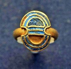 Minoan ring in the shape of a shield from the Aegina Treasure, 1850-1550 BC British Museum