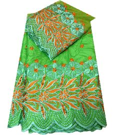 Bazin Fabric 100% Cotton and top and bottom both side Embroidery. Usages: African wedding dress, Costume Design, Blouse.