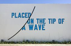 Lawrence Weiner, PLACED ON THE TIP OF A WAVE 2009. Language + the materials referred to. Dimensions variable