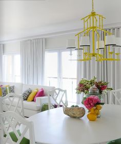 This feels close to what i want, I want a tulip table and green and white in fam room.