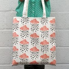 • Dispatched within 7 days • FREE UK delivery available • International delivery available • Made in the UK An illustrated raining clouds cotton tote bag that has long handles which fit comfortably over your shoulder.