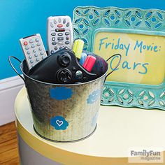 "Double-Duty Decorations: Stop asking ""where's the remote?"": If you let kids decorate a special container for corralling the remote controls, they might even use it! Also, post a sign of good things to come. One easy way to do it: turn a glass picture frame into a ""coming attractions"" sign for upcoming family movie nights."