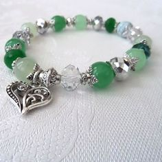 Handmade green gemstone and crystal stretchy bracelet, with heart charm by Beadstorm Jewellery