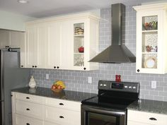 Gray Glass Subway Tile Backsplash In Cream Kitchen Cabinet With Stove On Black Granite Counter Top As Well As Wall Tiles Kitchen Backsplash  And Clear Glass Tile Backsplash Pictures