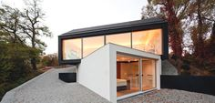 Cantilevered dual volume house in black and white