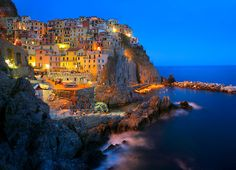 Italian coastal town Manarola at night