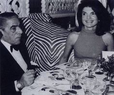 With husband, Aristotle Onassis at Maxims in Paris.