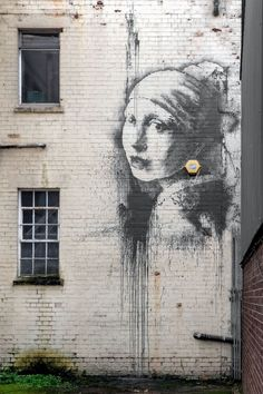 "Street art by Banksy depicting the painting ""Girl with a Pearl Earring"" by Dutch painter Johannes Vermeer on a wall in Bristol Harbourside, England art art graffiti art quotes Street Art Banksy, Banksy Art, Bansky, Berlin Graffiti, Pintura Graffiti, Graffiti Painting, Graffiti Artists, Johannes Vermeer, Amazing Street Art"