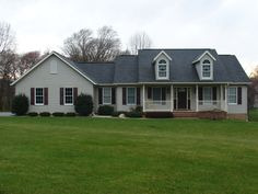 Front View. Custom rancher with two dormers to look like a cape cod, with vinyl siding and brick to grade.