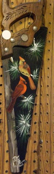 Cardinals painted on a saw blade!