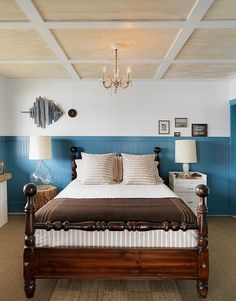 Beach Style Bedroom in blue and white palette and heavy wood beautiful bed