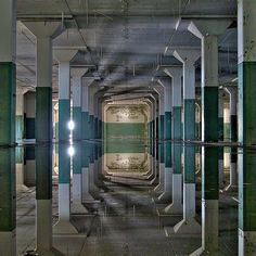 Hall of mirrors. An abandoned building in California that experienced flooding creating a surreal mirror image. Photo by Ed Roppo. by itsabandoned