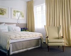 Lemon Zing by Vicente Wolf The pale yellow swirls of the wall mural and wooden floorboards of the community center find cohesion here in this room's drapery and bed linens.