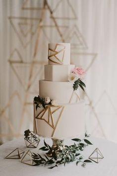modern white and gold wedding cake